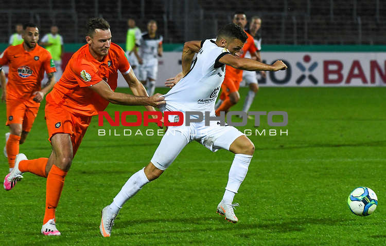 12.09.2020, Donaustadion, Ulm, GER, DFB Pokal, SSV Ulm 1846 Fussball vs FC Erzgebirge Aue, <br /> DFL REGULATIONS PROHIBIT ANY USE OF PHOTOGRAPHS AS IMAGE SEQUENCES AND/OR QUASI-VIDEO, <br /> im Bild Florian Ballas (Aue, #6) kann Ardian Morina (Ulm, #10) nur mit einem Foul (Halten am Trickot) stoppen<br /> <br /> Foto © nordphoto / Hafner
