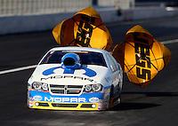 Nov 8, 2013; Pomona, CA, USA; NHRA pro stock driver Allen Johnson during qualifying for the Auto Club Finals at Auto Club Raceway at Pomona. Mandatory Credit: Mark J. Rebilas-