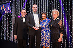© Joel Goodman - 07973 332324 . 05/03/2015 .  Midland Hotel , Manchester , UK . L-R Eamonn O'Neill , winner Alasdair Outhwaite of Eversheds LLP , sponsor (Eclipse Legal Systems) and Louise Straw . Pro Bono / Community Initiative of the Year . The Manchester Legal Awards 2015 . Photo credit : Joel Goodman
