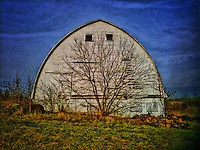Barn and farm implements in early winter colors.