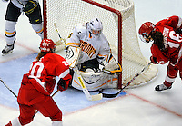 25 October 2008: University of Vermont Catamount goaltender Kristen Olychuck, a Junior from Kelowna, B.C., makes a save in the third period against the Cornell University Big Red at Gutterson Fieldhouse, in Burlington, Vermont. The Big Red defeated the Catamounts 5-1 to sweep their 2-game series in Vermont...Mandatory Photo Credit: Ed Wolfstein Photo