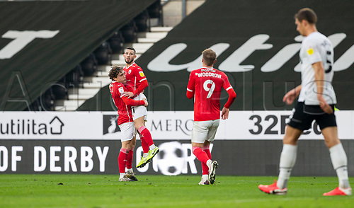 7th November 2020; Pride Park, Derby, East Midlands; English Football League Championship Football, Derby County versus Barnsley; Conor Chaplin of Barnsley  celebrates after taking the lead 0-1 in the 30th minute as he is picked up by Callum Styles of Barnsley