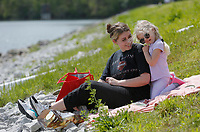 Mariah McLeod shares a moment with her daughter Baylor, 4, Monday, April 26, 2021, as they picnic on the side of the levee at Lake Fayetteville. Lake Fayetteville is a reservoir of Clear Creek created by Lake Fayetteville Dam in 1949. Check out nwaonline.com/210427Daily/ and nwadg.com/photos for a photo gallery.<br /> (NWA Democrat-Gazette/David Gottschalk)