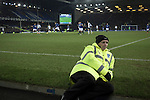 Everton 0 West Bromwich Albion 0, 19/01/2015. Goodison Park, Premier League. A steward taking up his pitch side position during the first half at Goodison Park, Liverpool of the Premier League match between Everton and West Bromwich Albion. The match ended in a 0-0 draw, despite the home team missing a first-half penalty by Kevin Mirallas. The game was watched by 34,739 spectators and left both teams languishing near the relegation zone. Photo by Colin McPherson.