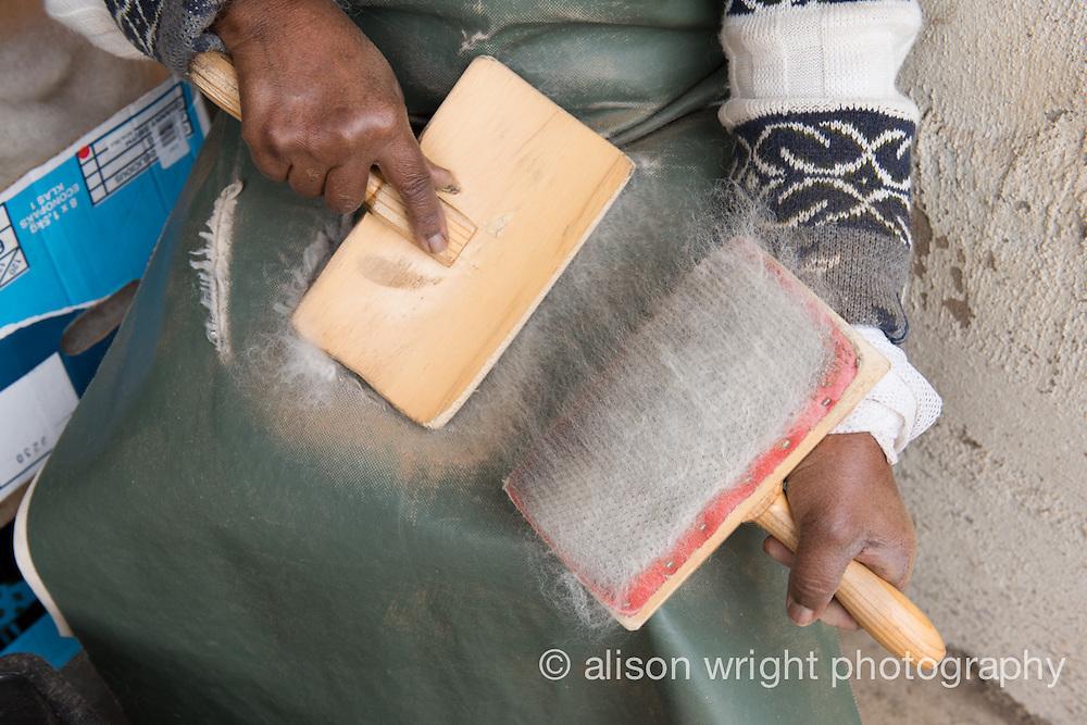 Africa, Swaziland, Malkerns. Nest organization artisan project, partnering with Coral Stephens handweaving workshop. Women carding wool.
