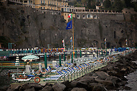 Sunbathers enjoy themselves on a private beach on Saturday, Sept. 19, 2015, in Sorrento, Italy. (Photo by James Brosher)