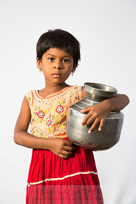 Renuka Kamble, 7, helps her family to collect pots of water everyday from public taps in the drought-hit city of Latur.