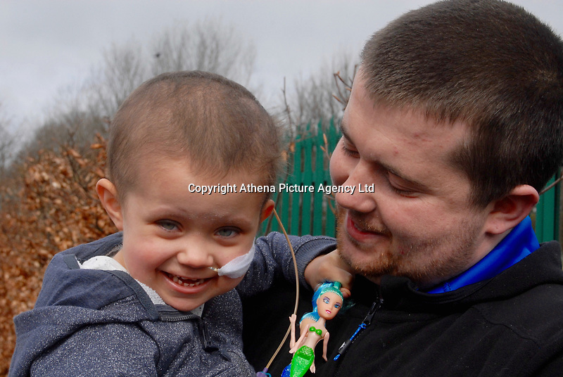 """COPY BY TOM BEDFORD<br /> Pictured L-R: Mia Chambers with her dad Josh <br /> Re: One of Britain's poorest towns is raising £100,000 to send a little girl to America because the lifesaving drugs she needs are not available on the NHS.<br /> Brave Mia Chambers, five, is in remission after having an ovary and kidney removed due to neuroblastoma, a rare and aggressive type of cancer.<br /> Doctors have told her parents Josh and Kirsty there is a 50 per cent chance of the cancer returning without the specialist drugs.<br /> Josh, 28, said: """"That's not a chance we are prepared to take - the odds are too high.<br /> """"We researched it on the internet and found children in the US are beating this terrible illness.<br /> """"Doctors there are willing to treat her but it will cost more money than we have.""""<br /> The couple's plight has touched the hearts of people in their home town of Merthyr Tydfil, South Wales, and money has begun pouring in.         <br /> Mia had chemotherapy on the Rainbow ward at the Noah's Ark Children's Hospital for Wales where nurses nicknamed her the Rainbow Warrior because of her fighting spirit."""