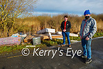 Tom Whyte (front right) and Johnny Foley at illegal dumping site in Ballinagare Bog in Lixnaw on Monday.