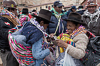 A picture dated Saturday January 26, 2013 shows two Quechua women greeting at the Miners Carnival in the Andes city of Potosi in Bolivia.  Already in 1663 the Spanish chronicler Marquez Jerez de los Caballeros described the colorful  miners carnival in Potosi. Four centuries later, the tradition of the legendary Cerro Rico miners is  still alive ..