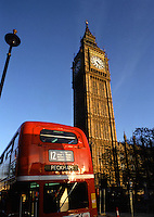 Big Ben and the British Parliament building with a Double Decker bus in the foreground. London, England.