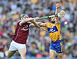 Cathal Mannion of Galway in action against Seadna Morey of Clare during their All-Ireland semi-final at Croke Park. Photograph by John Kelly.
