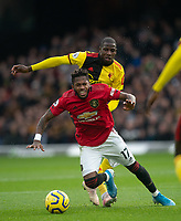 Abdoulaye Doucouré of Watford & Fred of Man Utd during the Premier League match between Watford and Manchester United at Vicarage Road, Watford, England on 22 December 2019. Photo by Andy Rowland.
