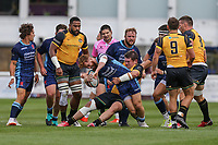 Rory Jennings of London Scottish is tackled during the Greene King IPA Championship match between London Scottish Football Club and Ealing Trailfinders at Richmond Athletic Ground, Richmond, United Kingdom on 8 September 2018. Photo by David Horn.
