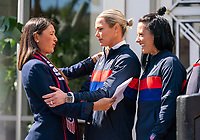 ORLANDO, FL - FEBRUARY 28: Tiffany Roberts Sahaydak talks with Ashlyn Harris #18 and  Ali Krieger #11 of the United States following a SheBelieves press conference at City Hall on February 28, 2020 in Orlando, Florida.