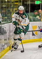 19 January 2018: University of Vermont Catamount Forward Liam Coughlin, a Junior from South Boston, MA, controls the puck behind the Lowell net during the second period against the University of Massachusetts Lowell Riverhawks at Gutterson Fieldhouse in Burlington, Vermont. The Riverhawks rallied to defeat the Catamounts 3-2 in overtime of their Hockey East matchup. Mandatory Credit: Ed Wolfstein Photo *** RAW (NEF) Image File Available ***