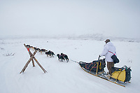 Rick Swenson passes a tripod marker in Ptarmigan Valley in the Alaska Range on his way to Rainy Pass and the Rohn checkpoint during Iditarod 2009