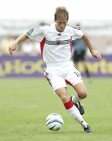 26 June 2004:   DC United Brian Carroll in action against Dallas Burn at Cotton Bowl in Dallas, Texas.   DC United and Dallas Burn are tied 1-1 after the game.   Credit: Michael Pimentel / ISI