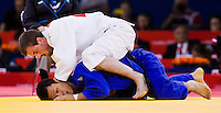 29 JUL 2012 - LONDON, GBR - Colin Oates (GBR) of Great Britain tries to overpower Cho Jun-Ho (KOR) of South Korea during their men's -66kg category repechage contest in the London 2012 Olympic Games judo at the ExCel Exhibition Centre in London, Great Britain (PHOTO (C) 2012 NIGEL FARROW)