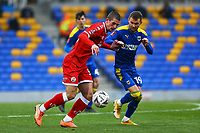 Max Watters of Crawley Town and Shane McLoughlin of AFC Wimbledon during AFC Wimbledon vs Crawley Town, Emirates FA Cup Football at Plough Lane on 29th November 2020