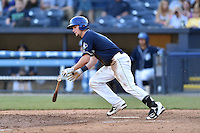 Asheville Tourists second baseman Brendan Rodgers (1) swings at a pitch during a game against the Hagerstown Suns at McCormick Field on April 28, 2016 in Asheville, North Carolina. The Tourists were leading the Suns 6-5 when the game was delayed in the top of the 6th inning due to darkness. (Tony Farlow/Four Seam Images)