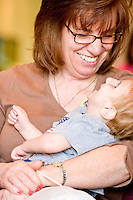 Families at the Share and Care Network's annual retreat held at the Doubletree Guest Suites Hotel in Boston on May 20, 2006. <br /> <br /> The Share and Care Network was created in 1981 by Pat Cahill when her son Scott was diagnosed with Cockayne Syndrome.  A rare form of dwarfism, Cockayne Syndrome is a genetically determined condition whose symptoms include microcephaly, mental retardation, progressive blindness, progressive hearing loss, premature aging, and a shortened lifespan averaging 18 years.  Those afflicted have distinctive facial features, including sunken eyes, pinched faces, and protruding jaws as well as distinctive gregarious, affectionate personalities.<br /> <br /> Because of the rarity of the condition (1/1,000 live births) and its late onset (characteristics usually begin to appear only after one year), many families and physicians are often baffled by children whose health begins to deteriorate after normal development.  It was partly with this in mind that the Share and Care Network was formed, to promote awareness of this disease as well as to provide a support network for those families affected.  In 1998 it began organizing an annual retreat, which has grown from three families in its inaugural year to more than 30 today.  Although the retreat takes place in the United States, families from as far as Japan arrive for this one weekend out of the year to share information and to support one another.