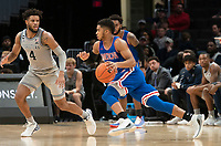 WASHINGTON, DC - DECEMBER 28: Sa'eed Nelson #0 of American dribbles towards Jagan Mosely #4 of Georgetown. during a game between American University and Georgetown University at Capital One Arena on December 28, 2019 in Washington, DC.