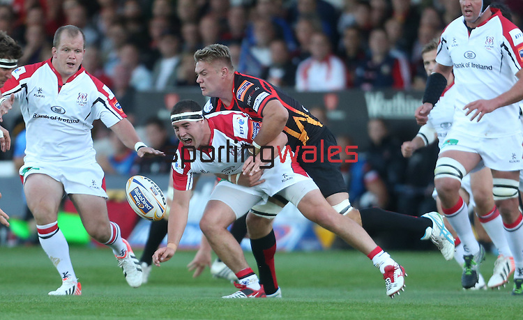 Ulster hooker Rob Herring slips the ball away as Dragons number 8 Lewis Evans makes the tackle.<br /> RaboDirect Pro 12<br /> Newport Gwent Dragons v Ulster<br /> Rodney Parade<br /> 06.09.13<br /> <br /> ©Steve Pope-SPORTINGWALES