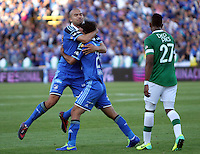 BOGOTA -COLOMBIA. 05-04-2014. Fabian Vargas (Der) de Millonarios   celebra su gol con Andres Cadavid (Izq) contra el Deportivo Cali  por la quinceava  fecha de La liga Postobon 1 disputado en el estadio Nemesio Camacho El Campin. /   Fabian Vargas (R)  and Andres Cadavid of Millonarios  celebrates his goal  against Deportivo Cali  during the match for the fifteenth  round of The Postobon one league match at Nemesio Camacho El Campin  Stadium . Photo: VizzorImage/ Felipe Caicedo / Staff