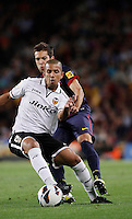 02/09/2012 - Liga Football Spain, FC Barcelona vs. Valencia CF Matchday 3 - Feghouli from Valencia CF controls the ball with Jordi Alba from FC Barcelona on his back