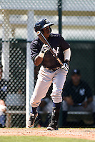 Shortstop Jorge Mateo (11) of the New York Yankees organization during a minor league spring training game against the Pittsburgh Pirates on March 22, 2014 at Pirate City in Bradenton, Florida.  (Mike Janes/Four Seam Images)