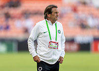 HOUSTON, TX - JUNE 13: Randy Waldrum of Nigeria watches his team during a game between Nigeria and Portugal at BBVA Stadium on June 13, 2021 in Houston, Texas.