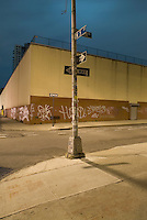 Street Scene at Night with One Way Signs, Industral Buildings, and Graffiti in the Williamsburg neighborhood of Brooklyn, New York City, New York State, USA