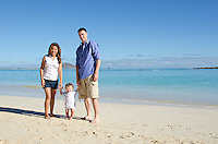 Portrait of parents and infant son on Kailua beach, O'ahu