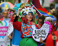 A woman with an Equal Marriage in Northern Ireland placard in this year's Pride Parade in the centre of Cardiff, Wales, UK. Sayurday 26 August 2017