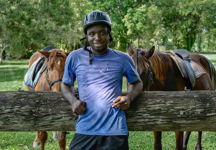 Portrait of a Jamaican horseback riding tour guide, Jamaica