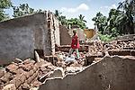 CAR, Bangui: A boy is posing in the PK5 neighborhood where several houses have been destroyed and sometimes burnt during the fights with the anti-balaka. 16 April 2016<br /> <br /> RCA, Bangui : Un garçon pose dans le quartier PK5 où plusieurs maisons ont été détruites et parfois brûlées pendant les combats avec les anti- Balaka . 16 avril 2016