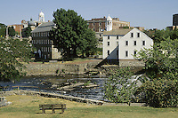 Pawtucket, R.I..Looking across the Blackstone River to historic Slater's Mill (ca 1790) which brought the textile industry to the US .