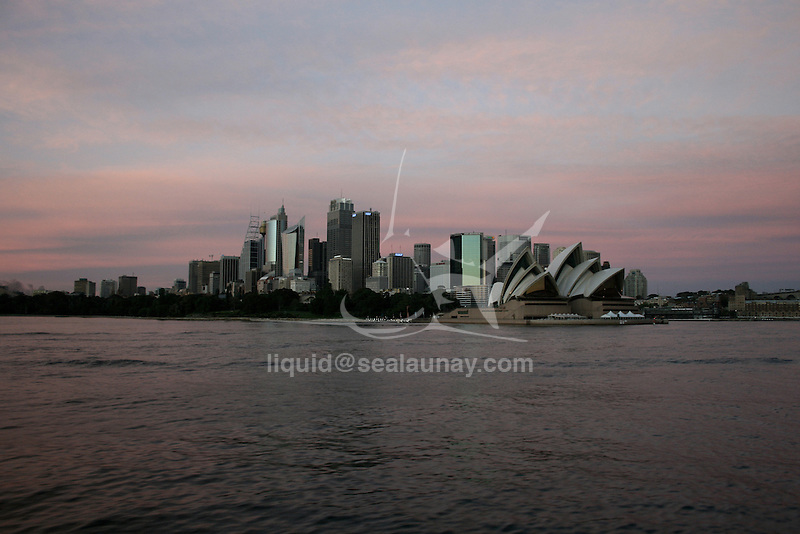 Arrival at Circular Quays by a Sydney Ferries coming from Manly  passing close by the Opera House, early in the morning.