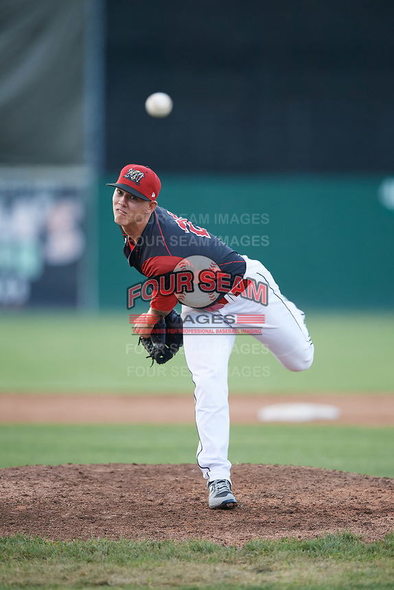 Batavia Muckdogs relief pitcher Shane Sawczak (21) delivers a warmup pitch during a game against the Auburn Doubledays on June 19, 2017 at Dwyer Stadium in Batavia, New York.  Batavia defeated Auburn 8-2 in both teams opening game of the season.  (Mike Janes/Four Seam Images)