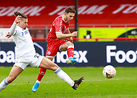 10th January 2021; Broadfield Stadium, Crawley, Sussex, England; English FA Cup Football, Crawley Town versus Leeds United; Nicholas Tsaroulla of Crawley shoots and scores for 1-0 in the 50th minute with Kalvin Phillips of Leeds united unable to block