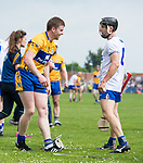 Tony Kelly of Clare smiles at Jamie Barron of Waterford after an incident where he was floored by Kevin Moran of Waterford during their Munster  championship round robin game at Cusack Park Photograph by John Kelly.