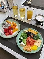Nanjing, Jiangsu, China.  Breakfast Fruit Dish:  Kumquats, Watermelon, Dragon Fruit, Peaches.  Smoked Salmon, cheese, mushrooms, seaweed.  Fruit Juices, Cappuccinno.