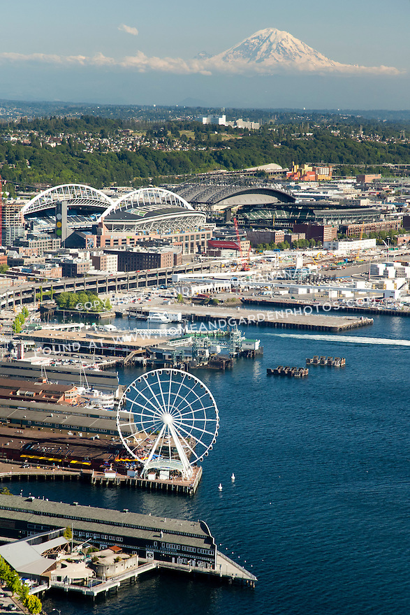 Aerial view of Seattle's waterfront and stadiums with Mt. Rainier in the background