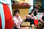 © Joel Goodman - 07973 332324 . 27/12/2017. Wigan, UK. People sit on the floor inside a takeaway . Revellers in Wigan enjoy Boxing Day drinks and clubbing in Wigan Wallgate . In recent years a tradition has been established in which people go out wearing fancy-dress costumes on Boxing Day night . Photo credit : Joel Goodman