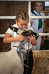 Quinn Ferguson kisses her lamb one last time before the sale at the 56th Junior Livestock Auction, Back in the Saddle Again, Sunday at the 82nd Amador County Fair, Plymouth, California<br /> .<br /> .<br /> .<br /> @AmadorCountyFair, #1SmallCountyFair, #VisitAmador, #PlymouthCalifornia, #AmadorCountyFair, #Best4DaysOfSummer, #AmadorCounty, #26thDAA