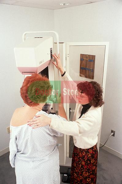 Woman prepares for mammogram