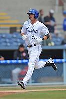 Asheville Tourists center fielder David Dahl #21 rounds the bases after homering during a game against the  Delmarva Shorebirds at McCormick Field on April 6, 2014 in Asheville, North Carolina. The Shorebirds defeated the Tourists 4-2. (Tony Farlow/Four Seam Images)