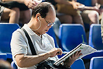 A racegoer read race information during Hong Kong Racing at Happy Valley Racecourse on September 05, 2018 in Hong Kong, Hong Kong. Photo by Yu Chun Christopher Wong / Power Sport Images