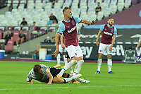 Andriy Yarmolenko of West Ham United is tackled by Ben Purrington of Charlton Athletic FC during West Ham United vs Charlton Athletic, Caraboa Cup Football at The London Stadium on 15th September 2020